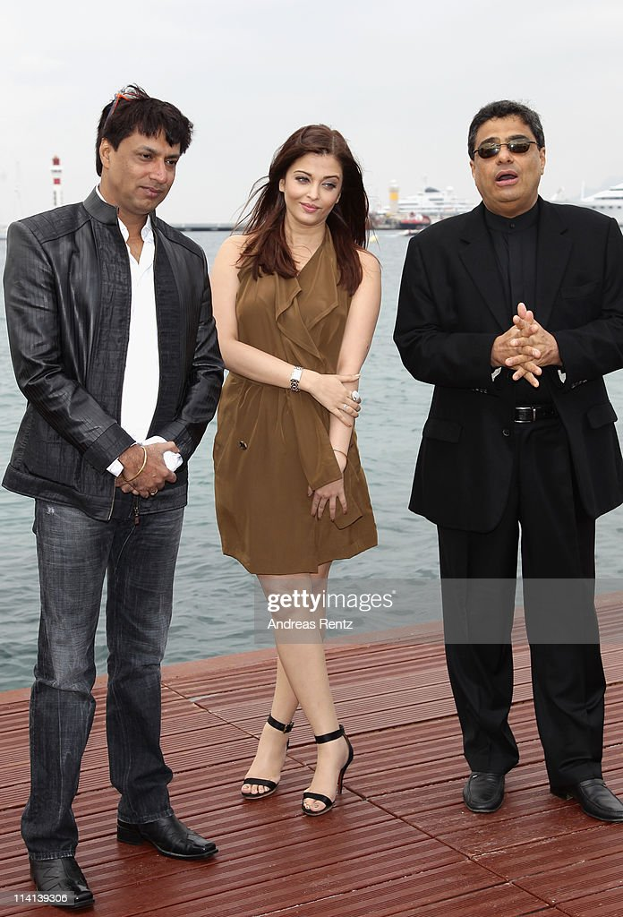 Filmmaker Madhur Bhandarkar actress Aishwarya Rai and producer Ronnie Screwvala attend a photocall at the Majestic Beach Pier during the 64th Cannes..