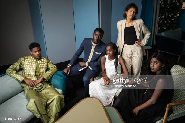 Filmmaker Mati Diop and cast from 'Atlantique' poses for a portrait on May 18 2019 in Cannes France