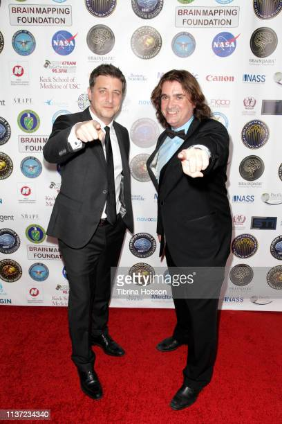 Filmmaker Matt Rhodes and Dr Harry Kloor attend the 16th annual 'Gathering for Cure' black tie awards gala of Brain Mapping Foundation on March 16...