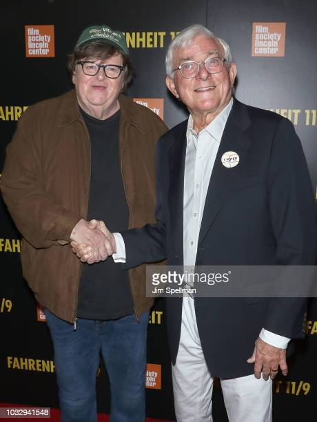 Filmmaker Michael Moore and media personality Phil Donahue attend the Fahrenheit 11/9 New York premiere at Alice Tully Hall Lincoln Center on...
