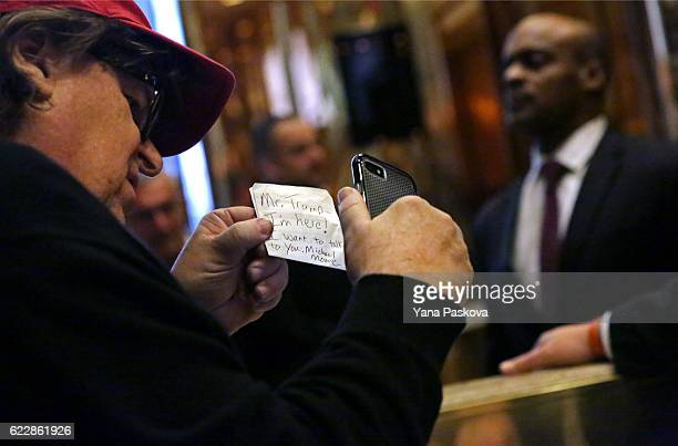 Filmmaker Michael Moore leaves a note for Presidentelect Donald Trump at Trump Tower on November 12 2016 in New York City Presidentelect Donald Trump...