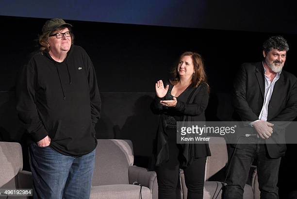 Filmmaker Michael Moore producers Tia Lessin and Carl Deal attend the Centerpiece Gala Premiere of Dog Eat Dog Films' 'Where to Invade Next' during...