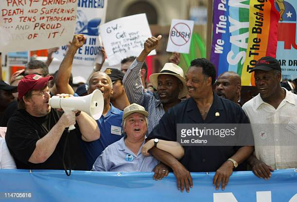 Filmmaker Michael Moore Rev Jessie Jackson and actor Danny Glover chant outside Madison Square Garden during a protest against the Iraq war on the...
