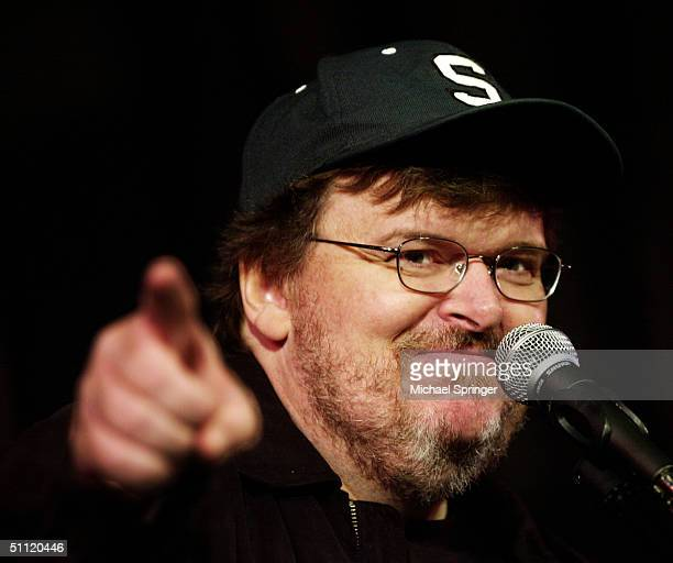 Filmmaker Michael Moore talks to reporters during a news conference at the Coolidge Theatre July 27, 2004 in Brookline, Massachusetts. Moore was at...