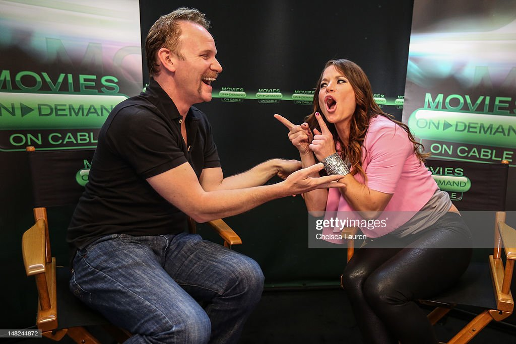 Filmmaker Morgan Spurlock (L) and Movies On Demand host Camille Ford speak at the Movies On Demand lounge at Comic Con at Hard Rock Hotel San Diego on July 12, 2012 in San Diego, California.