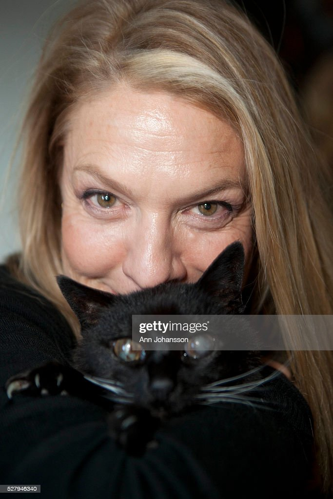 Filmmaker Nina Menkes poses for photographs with her 17-year old and blind cat Eiko Peiko at her home in Venice, February 5, 2012.