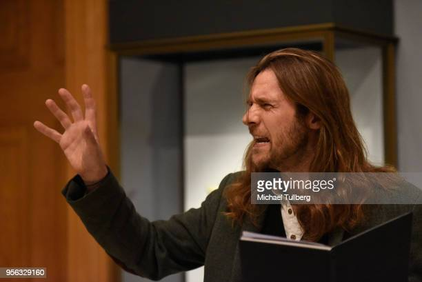 Filmmaker Oscar Sharp recites Gabriele Tinti's poetry at BritWeek at The Getty Villa on May 8 2018 in Pacific Palisades California