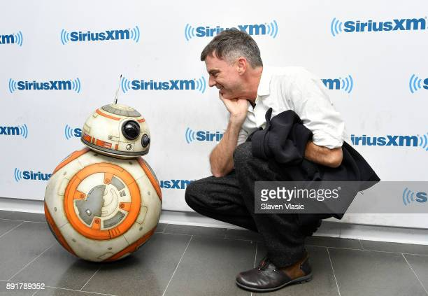 Filmmaker Paul Thomas Anderson poses with Star Wars character Astromech Droid BB8 at SiriusXM Studios on December 13 2017 in New York City