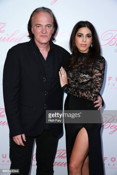 Filmmaker Quentin Tarantino and Daniella Pick attend the premiere of Focus Features' The Beguiled at the Directors Guild of America on June 12 2017...