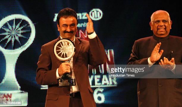 Filmmaker Rajkumar Hirani receiving CNN IBN Indian of the year 2006 Award from Lok Sabha Speaker Somnath Chatterjee February 7 2007 in New Delhi...