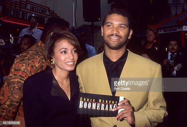 Filmmaker Reginald Hudlin and date attend the 'Boomerang' Hollywood Premiere on June 28 1992 at the Mann's Chinese Theatre in Hollywood California