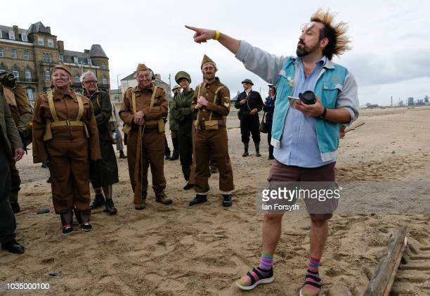Filmmaker Richard DeDomenici directs volunteers as they prepare to take part in filming for a Redux version of the Dunkirk scene from the 2007 Oscar...