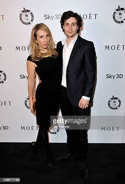 Filmmaker Sam TaylorWood and actor Aaron Johnson pose in the press room during The 31st London Film Critics' Circle Awards at BFI Southbank on...