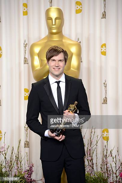 "Filmmaker Shawn Christensen, winner of the Best Live Action Short Film award for ""Curfew,"" poses in the press room during the Oscars held at Loews..."
