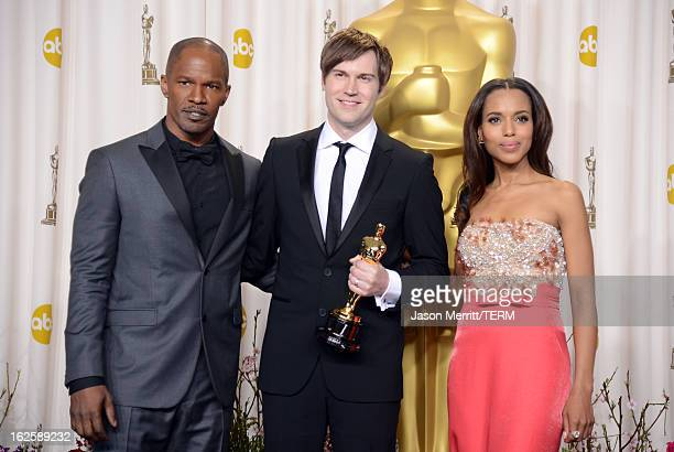 "Filmmaker Shawn Christensen , winner of the Best Live Action Short Film award for ""Curfew,"" with presenters Jamie Foxx and Kerry Washington , pose in..."