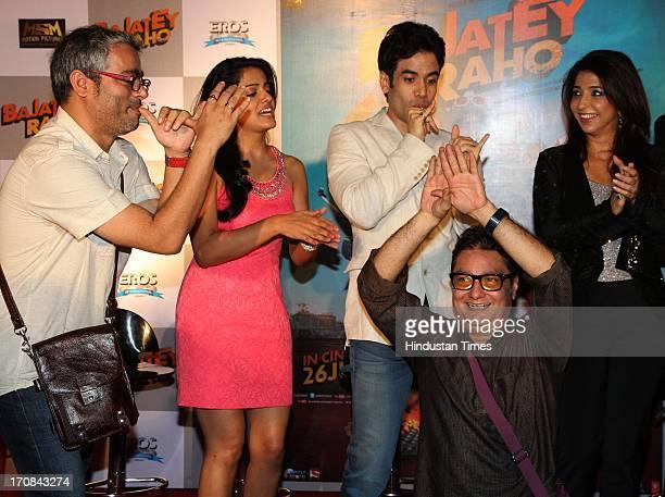 Filmmaker Shuashant A Shah and Bollywood actors Vishaka Singh and Tushar Kapoor with producer Krishika Lulla cheer as actor Vinay Pathak does a Nagin...