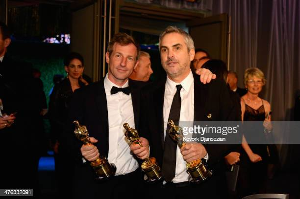 Filmmaker Spike Jonze and director Alfonso Cuaron attend the Oscars Governors Ball at Hollywood Highland Center on March 2 2014 in Hollywood...
