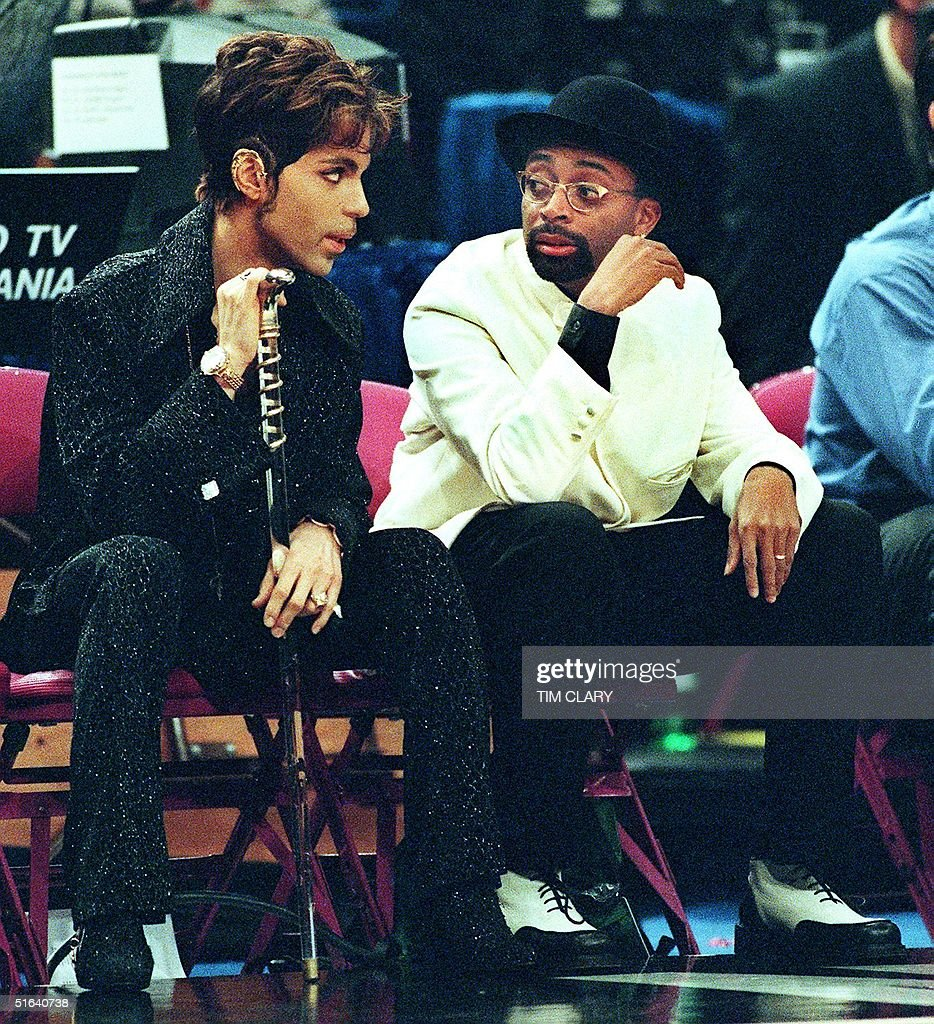 Filmmaker Spike Lee (R), a New York Knicks season ticket-holder, talks with the musician formerly known as Prince (L) during the NBA All-Star Game at Madison Square Garden 08 February. The Eastern Conference All-Stars beat the Western Conference 135-114. AFP PHOTO/Tim CLARY