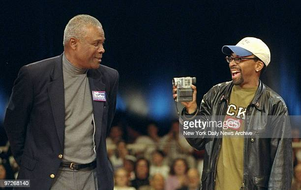 Filmmaker Spike Lee records former Boston Celtics' star K.C. Jones at a fund-raiser for Democratic presidential hopeful Bill Bradley in Madison...