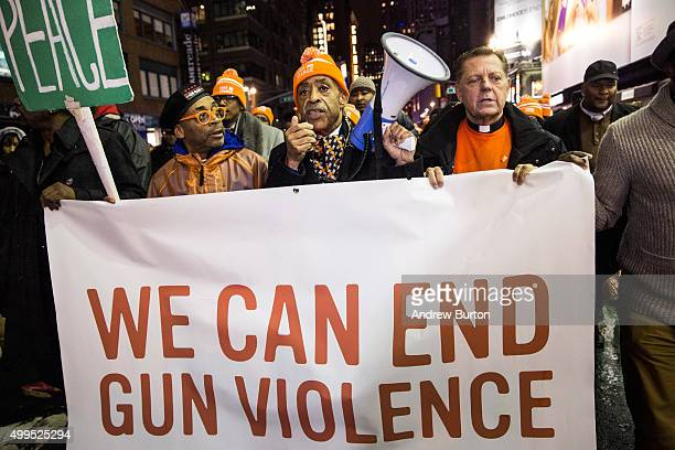 Filmmaker Spike Lee Reverend Al Sharpton and Father Michael Pfleger lead a march through the streets of Manhattan calling for an end to gun violence...