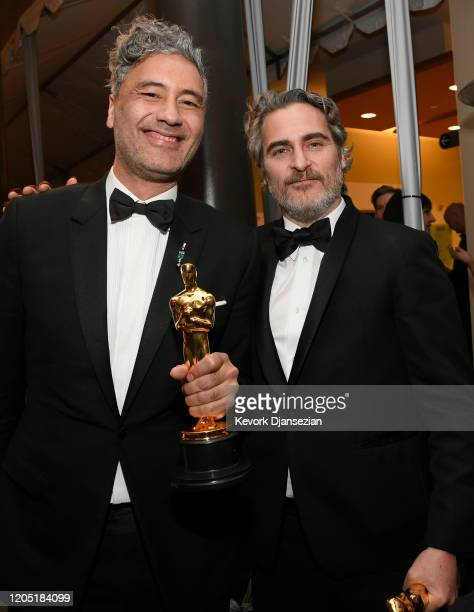 """Filmmaker Taika Waititi, winner of Best Adapted Screenplay for """"Jojo Rabbit,"""" and Joaquin Phoenix, winner of the Actor in a Leading Role award for..."""