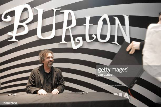 Filmmaker Tim Burton signs autographs at the TIFF Bell Lightbox on November 22 2010 in Toronto Canada