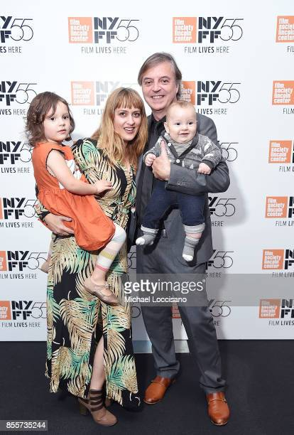 Filmmaker Travis Wilkerson poses with his wife Erin Wilkerson and their children Matilda and Dalton before a screening of 'Did You Wonder Who Fired...