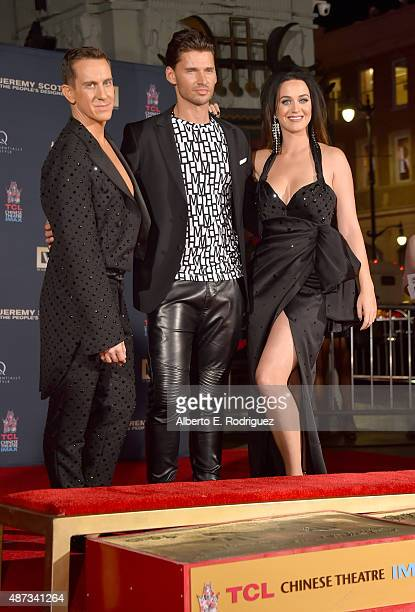 Filmmaker Vlad Yudin poses with designer Jeremy Scott and singer Katy Perry during their hand print ceremony at TCL Chinese Theatre IMAX Forecourt on...