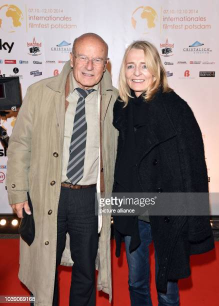 Filmmaker Volker Schloendorff festival patron poses with his wife Angelika during the opening of the 1st Potsdam International Film Festival in...