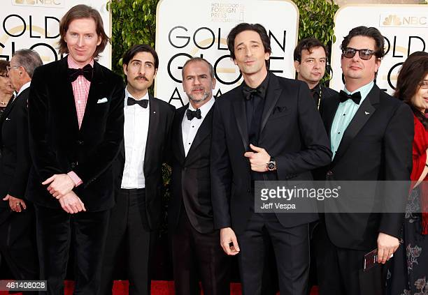 Filmmaker Wes Anderson actor Jason Schwartzman guest Adrien Brody and Roman Coppola attends the 72nd Annual Golden Globe Awards at The Beverly Hilton...