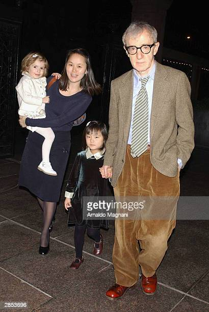 Filmmaker Woody Allen and his family daughter Manzie wife SoonYi and daughter Bechet pause on their way to New Year's Eve dinner at LeCirque...