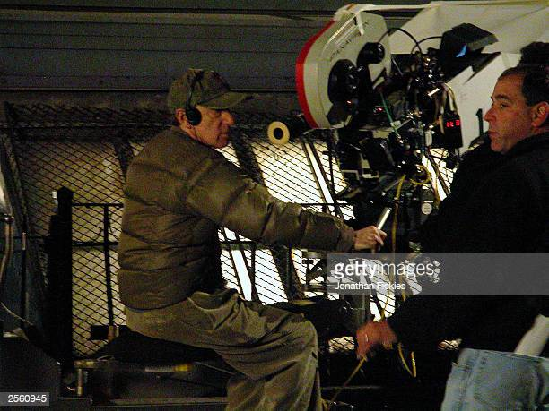 Filmmaker Woody Allen frames a shot through a camera during night filming of his latest fall production October 3 2003 in downtown New York City