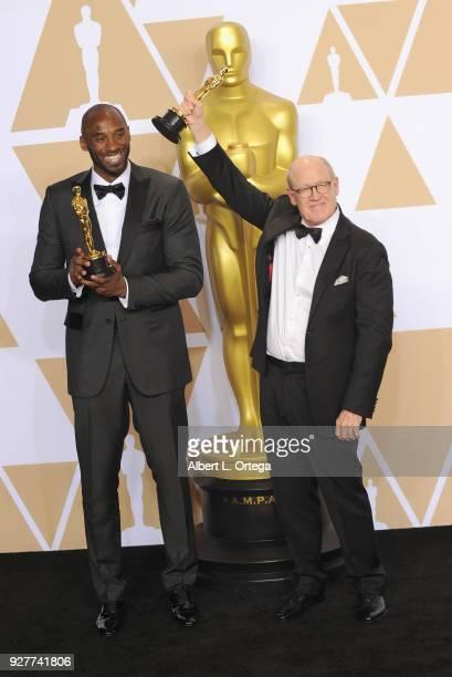 Filmmaker/former NBA player Kobe Bryant and filmmaker Glen Keane, winners of the Animated Short award for ?'Dear Basketball'? pose inside the Press...
