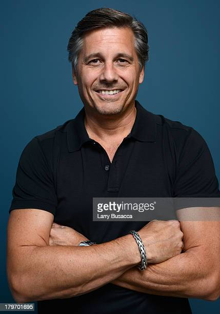 Filmmaker/photographer Kevin Mazur of '$ellebrity' poses at the Guess Portrait Studio during 2013 Toronto International Film Festival on September 6...