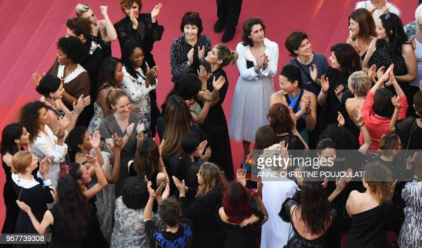 Filmmakers, actresses and producers applaud after Australian actress and President of the Jury Cate Blanchett read a statement on the red carpet in...