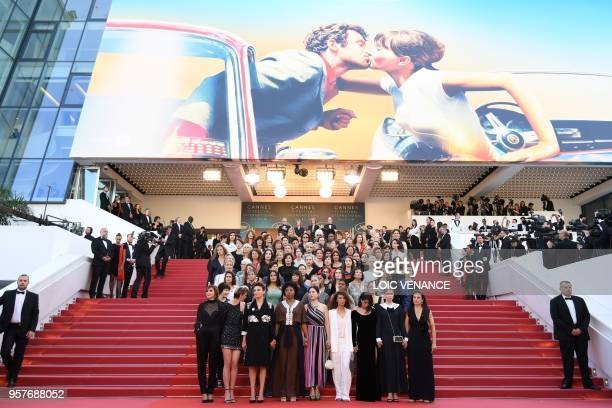 Filmmakers, actresses and producers listen to Australian actress Cate Blanchett read a statement on the steps of the red carpet in protest of the...
