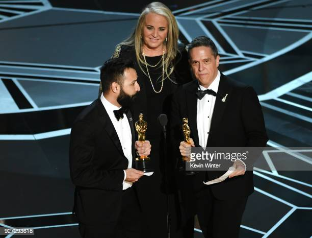 Filmmakers Adrian Molina Darla K Anderson and Lee Unkrich accept Best Animated Feature Film for 'Coco' onstage during the 90th Annual Academy Awards...