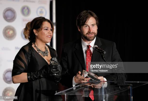 Filmmakers Billie Feldman and Sean Stone receive the Golden Axon Award at the 16th annual 'Gathering for Cure' black tie awards gala of Brain Mapping...