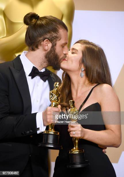 Filmmakers Chris Overton and Rachel Shenton, winners of the Best Live Action Short Film award for 'The Silent Child,' pose in the press room during...