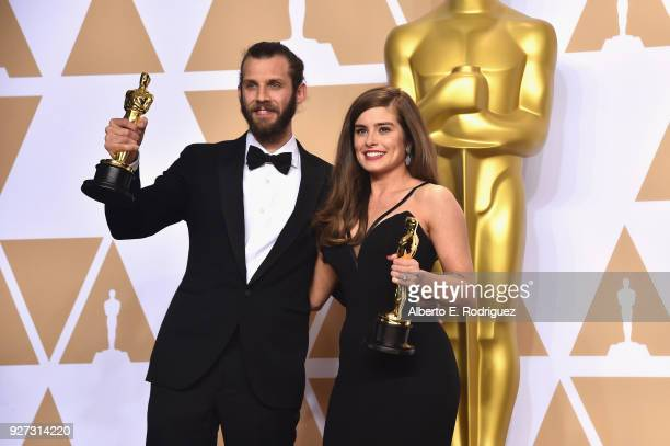 "Filmmakers Chris Overton and Rachel Shenton winners of the Live Action Short Film award for ""The Silent Child"" pose in the press room during the 90th..."