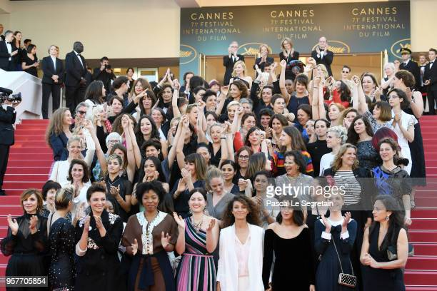 Filmmakers clap after Jury head Cate Blanchett with other filmmakers read a statement on the steps of the red carpet in protest of the lack of female...