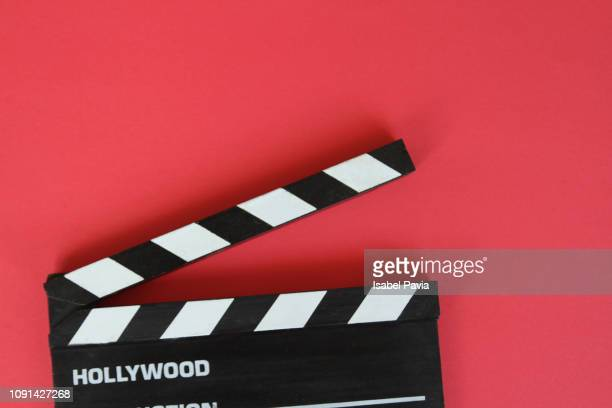filmmaker's clapboard on red background. - position stock-fotos und bilder