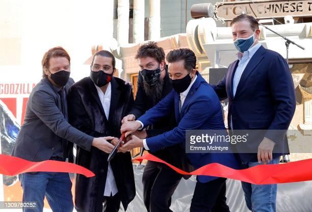 Filmmakers Gareth Edwards, Jordan Vogt-Roberts, Adam Wingard, Michael Dougherty, and CEO of Legendary Entertainment Joshua Grode cut the ribbon...