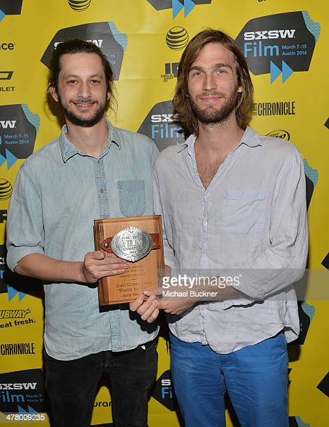 Filmmakers Ian Schwartz and Cooper Roberts pose with their award for Music Video during the 2014 SXSW Film Awards at the Paramount Theatre on March...