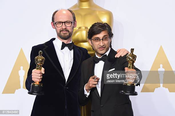 Filmmakers James Gay-Rees and Asif Kapadia winners of the Best Documentary Feature award for 'Amy' pose in the press room during the 88th Annual...