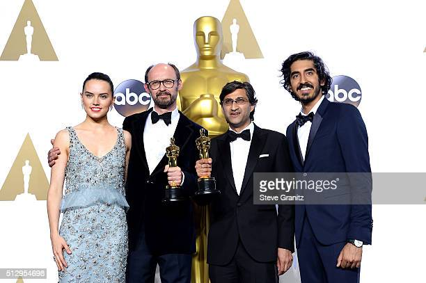 Filmmakers James Gay-Rees and Asif Kapadia , winners of the Best Documentary Feature award for 'Amy,' pose with actress Daisy Ridley and actor Dev...