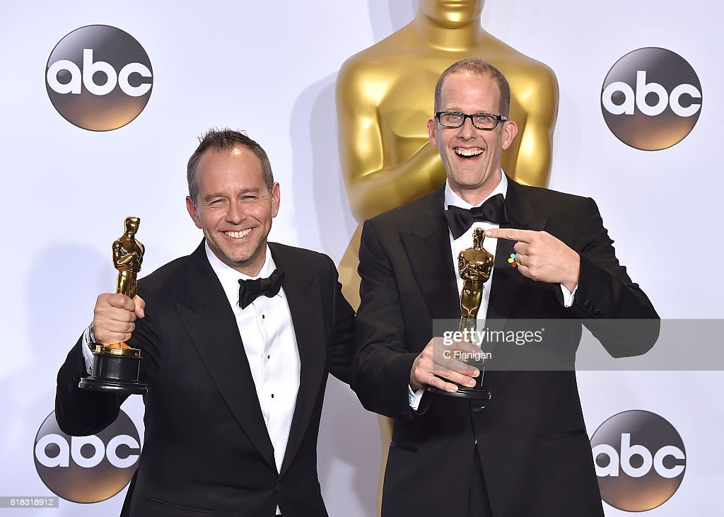 Filmmakers Jonas Rivera (L) and Pete Docter, winners of the Best Animated Feature award for 'Inside Out,' pose in the press room during the 88th Annual Academy Awards at Loews Hollywood Hotel on February 28, 2016 in Hollywood, California.