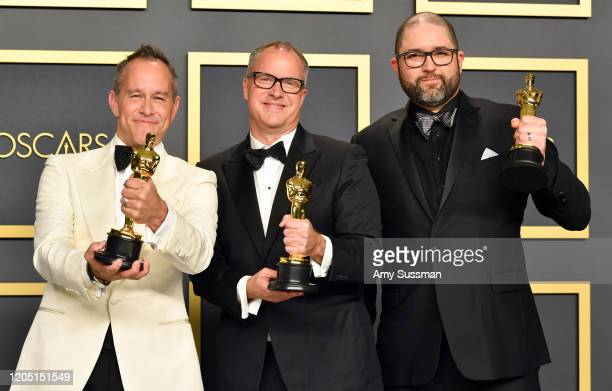 """Filmmakers Jonas Rivera, Mark Nielsen and Josh Cooley, winners of the Animated Feature Film award for """"Toy Story 4,"""" pose in the press room during..."""