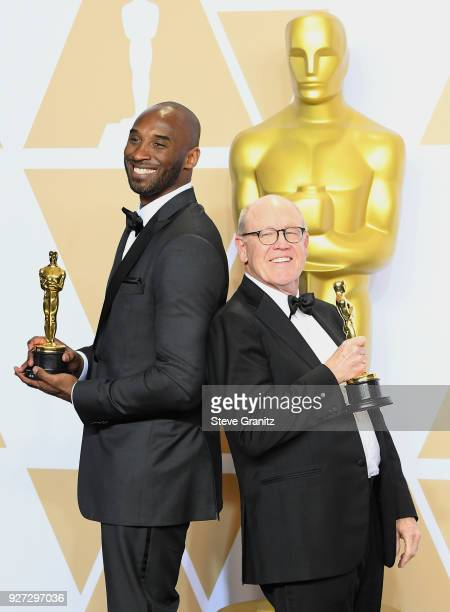 """Filmmakers Kobe Bryant and Glen Keane, winners of the Animated Short award for """"Dear Basketball"""" pose in the press room during the 90th Annual..."""