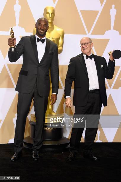 Filmmakers Kobe Bryant and Glen Keane winners of the Best Animated Short Film award for 'Dear Basketball' pose in the press room during the 90th...
